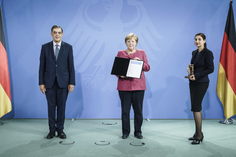 Romani Rose confers European Civil Rights Prize of the Sinti and Roma to German Chancellor Angela Merkel in Berlin